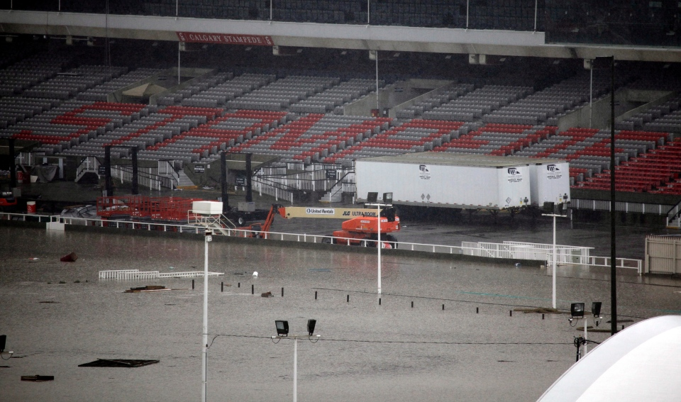 The Calgary Stampede rodeo grounds are flooded due to the heavy rains have caused flooding, closed roads, and forced evacuation in Calgary, Friday, June 21, 2013. (Jeff McIntosh / THE CANADIAN PRESS)