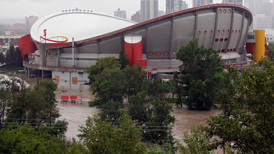 The Calgary Saddledome is flooded due to the heavy rains have caused flooding, closed roads, and forced evacuation in Calgary, Friday, June 21, 2013. (Jeff McIntosh / THE CANADIAN PRESS)