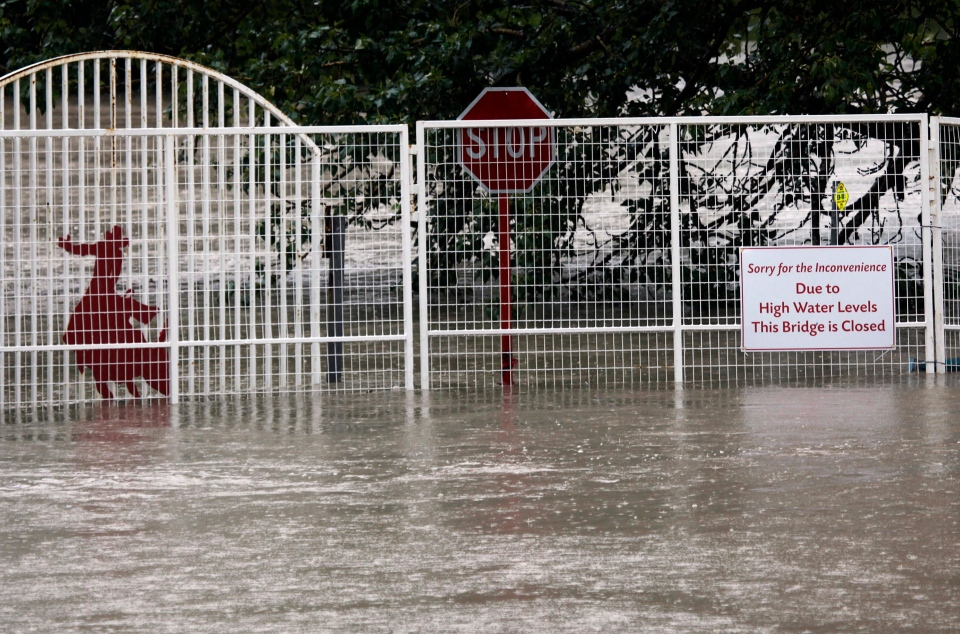 The Calgary Stampede grounds are flooded due to the heavy rains have caused flooding, closed roads, and forced evacuation in Calgary, Alta., Friday, June 21, 2013. (Jeff McIntosh / THE CANADIAN PRESS)