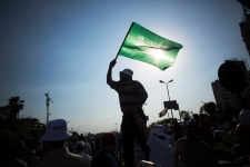 An Egyptian man waves an Islamic flag