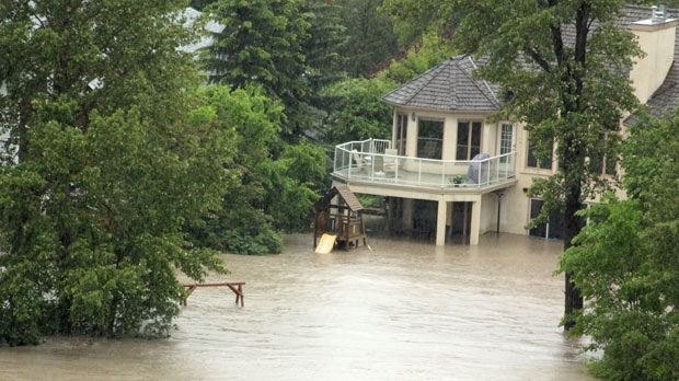 A home along the Bow River in Bowness is flooded out. (Photo Courtesy: John Trenholm)