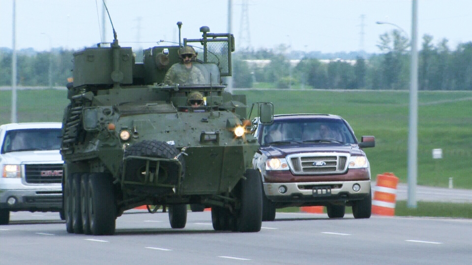 Soldiers drive a military vehicle down the highway en route to a flooded area of southern Alberta in this image from video on June 21, 2013.