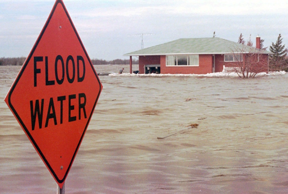 A house completely surrounded by flood waters from the Red River, in Grande-Pointe, Manitoba in the 1997 floods.(CP PHOTO)