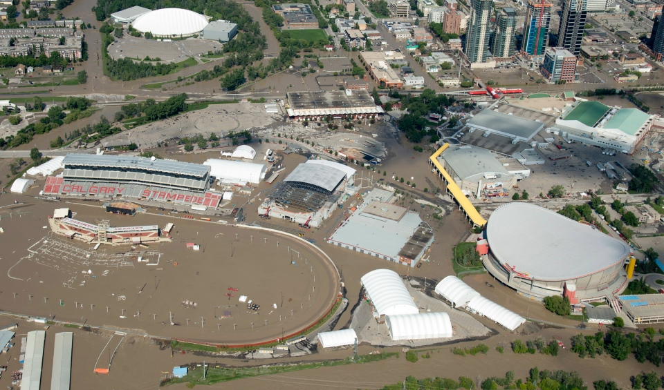 A flooded Calgary Stampede stadium and Saddledome is seen from a aerial view in Calgary, Alta., Saturday, June 22, 2013. (Jonathan Hayward / THE CANADIAN PRESS)