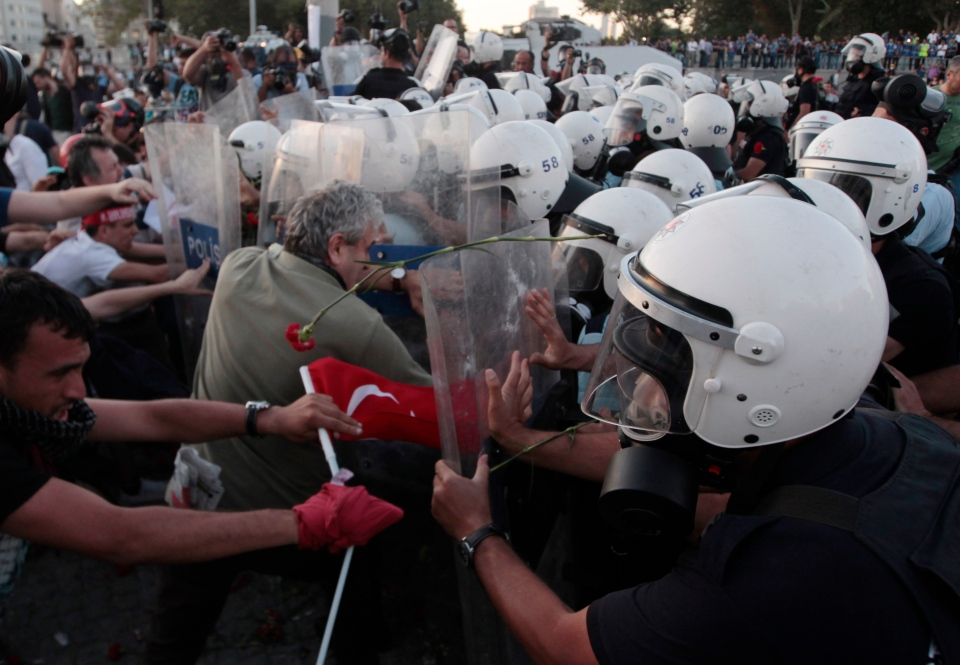 Riot policemen push protesters during clashes at Taksim Square in Istanbul, Turkey, Saturday, June 22, 2013. (AP / Petr David Josek)