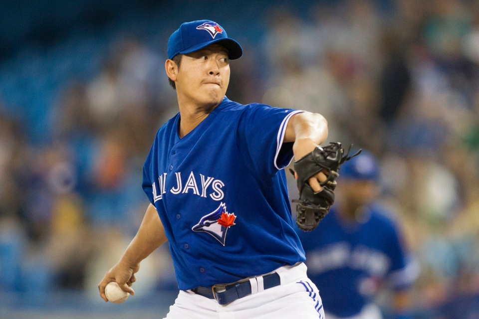 Toronto Blue Jays starting pitcher Chien-Ming Wang, of Taiwan, works against Baltimore Orioles during the first inning of a baseball game in Toronto, Saturday, June 22, 2013. (AP Photo/The Canadian Press, Chris Young)