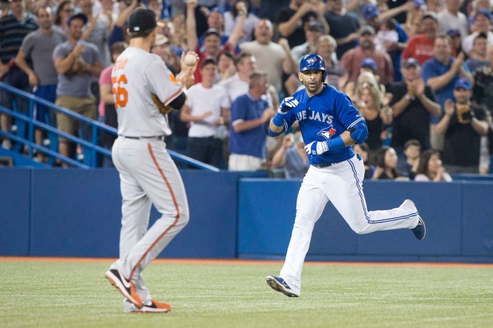 Toronto Blue Jays Jose Bautista (right) gestures to Baltimore Orioles Darren O'Day after hitting a home run during eighth inning AL baseball action in Toronto on Saturday June 22, 2013. THE CANADIAN PRESS/Chris Young