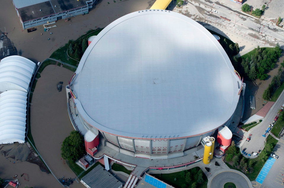 A flooded Calgary Saddledome is seen from a aerial view in Calgary, Saturday, June 22, 2013. (Jonathan Hayward / THE CANADIAN PRESS)
