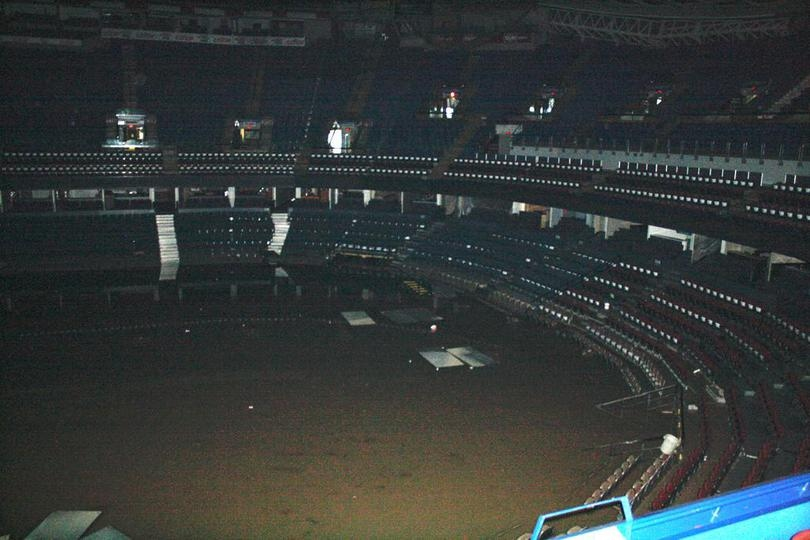 A photo posted Saturday on the Calgary Flames' official website shows the interior of the Scotiabank Saddledome. The flooding reached row eight.