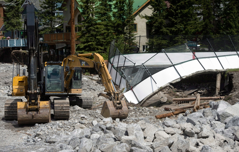 A hockey arena is seen fallen into the creek after a massive flood swept through the area in Canmore, Alta., Saturday, June 22, 2013. (Jonathan Hayward / THE CANADIAN PRESS)