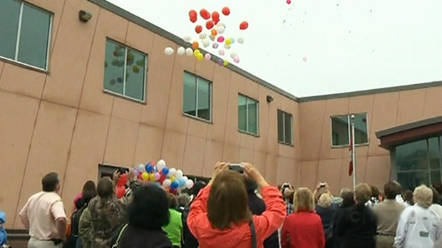 Residents of Elliot Lake, Ont., marked the one-year anniversary of the collapse of the town's shopping mall by releasing multi-coloured balloons carrying messages of remembrance into an overcast sky on Sunday, June 23, 2013.