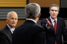 Liberal Leader Michael Ignatieff gestures to Prime Minister Stephen Harper, middle, as NDP Leader Jack Layton looks on during the English language federal election debate in Ottawa Ont., on Tuesday, April 12, 2011. (Adrian Wyld / THE CANADIAN PRESS)