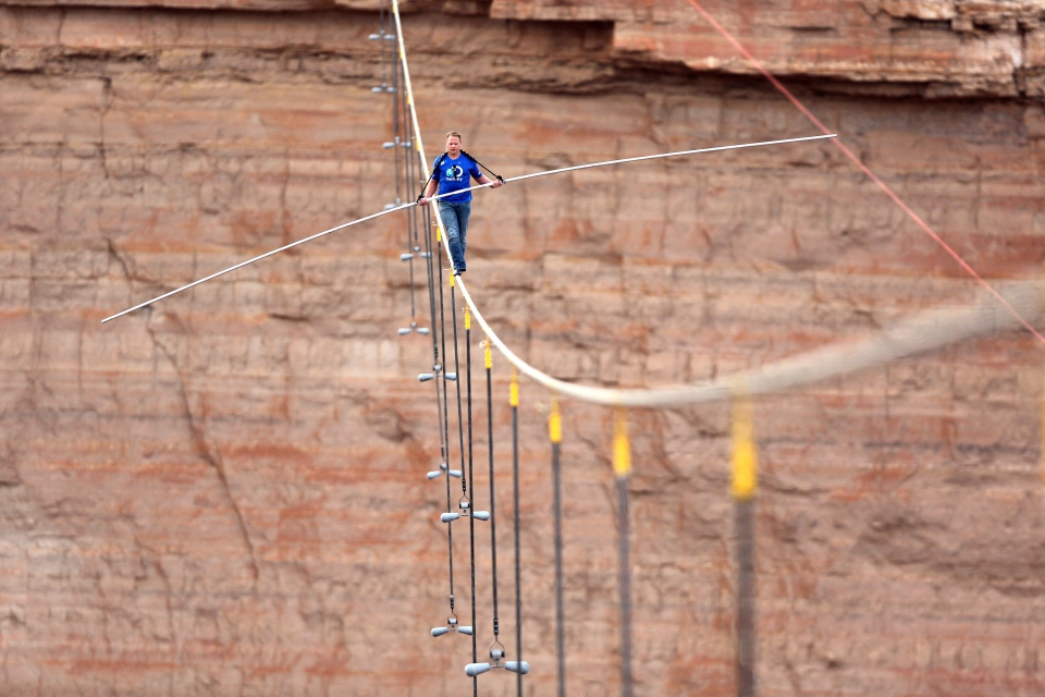 Aerialist Nik Wallenda walks a 2-inch-thick steel cable taking him a quarter mile over the Little Colorado River Gorge, Ariz. on Sunday, June 23, 2013. (Discovery Channel, Tiffany Brown)