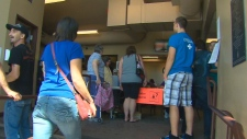 High River, Alta. residents in a temporary shelter