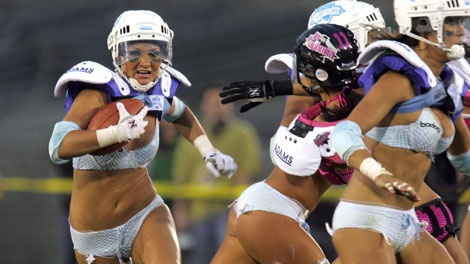 Los Angeles Temptation's Lauren Bergfeld picks up some yards against the New York Euphoria during the Lingerie Bowl at the Los Angeles Memorial Coliseum Sunday, Feb. 5, 2006, in Los Angeles.