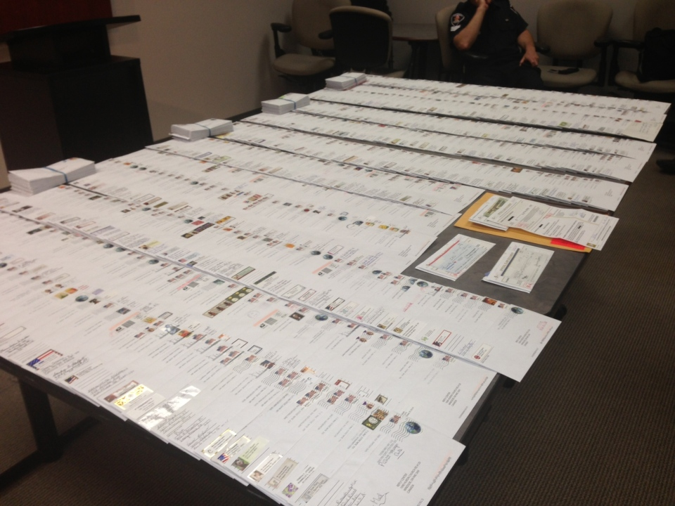 Windsor police display letters in a suspected mass marketing fraud in Windsor, Ont., on Monday, June 24, 2013. (Sacha Long / CTV Windsor)