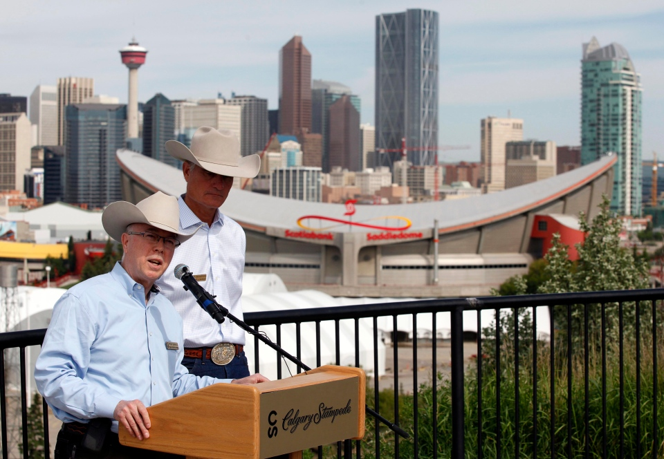 Calgary Stampede officials Vern Kimball, CEO, left, is shown in this file photo from June 24, 2013. (Jeff McIntosh / THE CANADIAN PRESS)