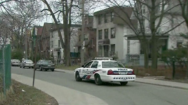 Police are seen driving through Toronto's Parkdale neighbourhood.