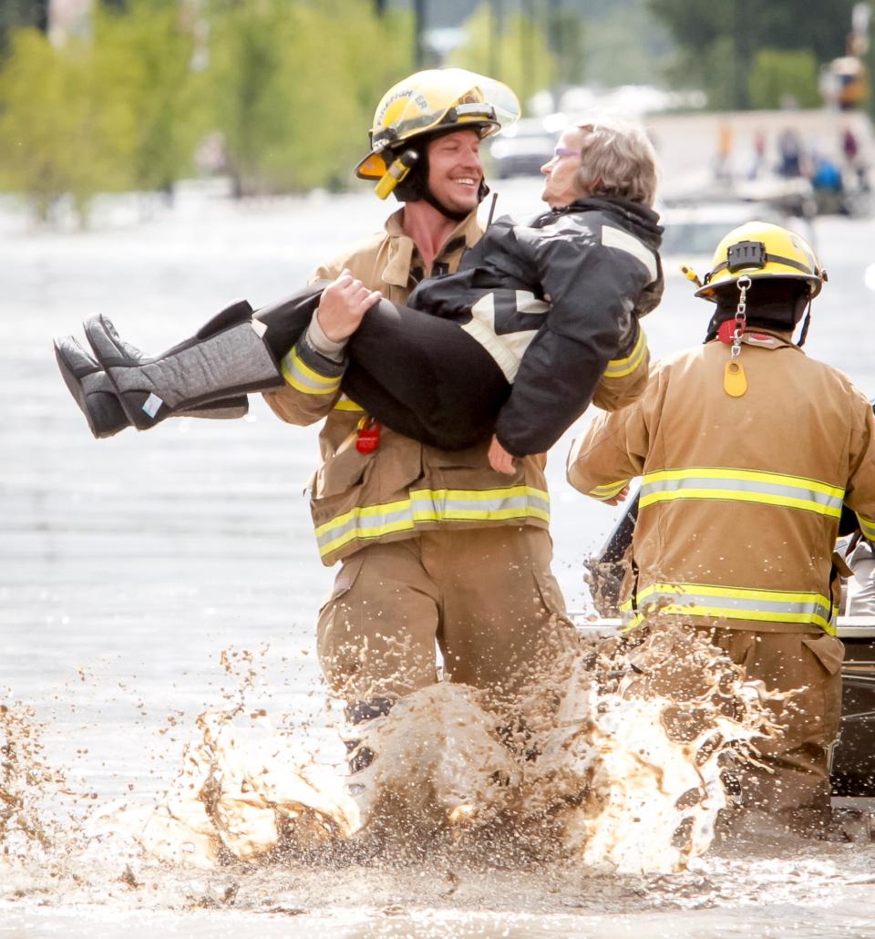 Smiling firefighter, High River flood