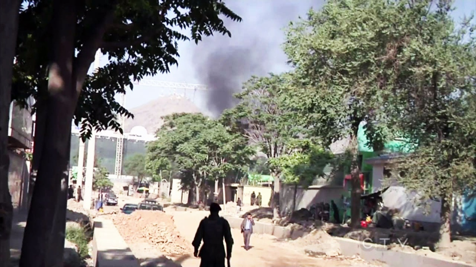 Smoke spews into the sky following a series of explosion outside the presidential palace in Kabul, Afghanistan, Tuesday, June 25, 2013.