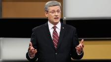 Stephen Harper answers a question during the English language federal election debate in Ottawa, Ont., on Tuesday, April 12, 2011. (Chris Wattie / THE CANADIAN PRESS)