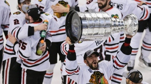 Chicago Blackhawks defenseman Michal Rozsival, of the Czech Republic, hoists the Stanley Cup after the Blackhawks beat the Boston Bruins 3-2 in Game 6 of the NHL hockey Stanley Cup Finals Monday, June 24, 2013, in Boston. (AP / Charles Krupa)