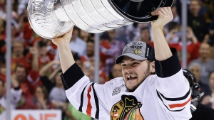 Chicago Blackhawks left wing Daniel Carcillo hoists the Stanley Cup after the Blackhawks beat the Boston Bruins 3-2 in Game 6 of the NHL hockey Stanley Cup Finals Monday, June 24, 2013, in Boston. (AP Photo/Elise Amendola)