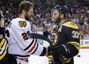 Chicago Blackhawks centre Michal Handzus (26), of Slovakia, shakes hands with Boston Bruins center Patrice Bergeron (37) after the Blackhawks beat the Bruins 3-2 in Game 6 of the NHL hockey Stanley Cup Finals Monday, June 24, 2013, in Boston. (AP / Elise Amendola)