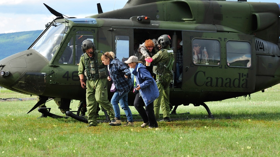 Canadian Forces assist in the evacuation of William Watson Lodge in Peter Lougheed Provincial Park with a CH-146 Griffon Utility Tactical Transport Helicopter from CFB Borden in Ontario.