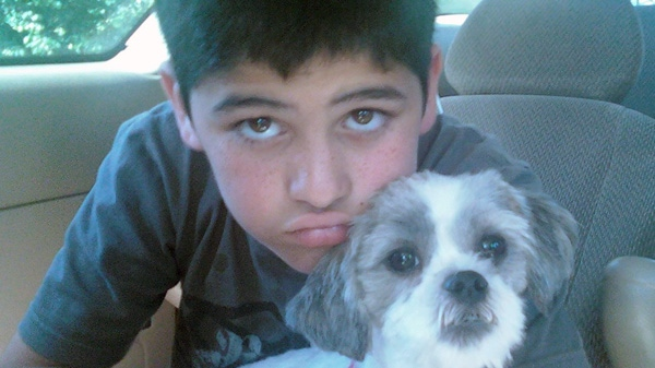 Jesse Lorange, 11, and his Shih Tzu, Bailey, appear in this undated file photo.