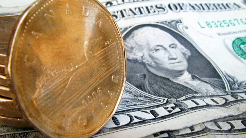 The loonie hit its lowest level in more than 12 years this week, briefly trading below 71 cents US, but one Canadian economist says the weak dollar isn't all bad news. (Paul Chiasson / THE CANADIAN PRESS)