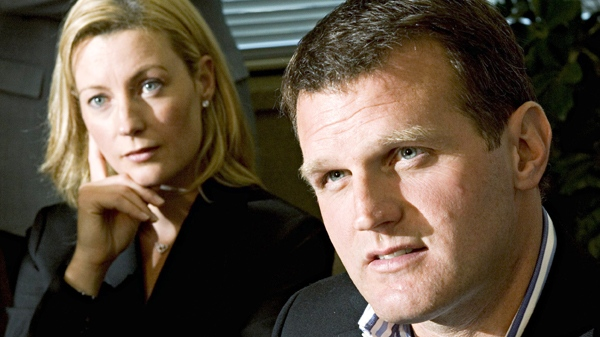 Vincent Damphousse speaks during his retirement announcement as his wife Allana listens, during a news conference in Laval, Que., on Sept. 7, 2005. (Paul Chiasson / THE CANADIAN PRESS)