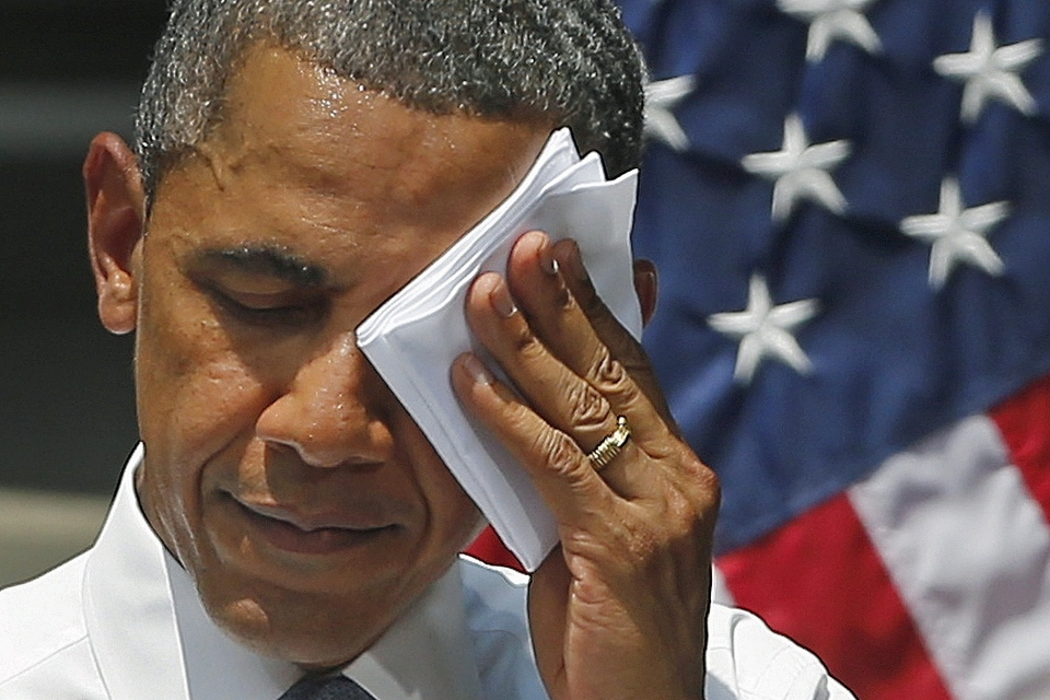 U.S. President Barack Obama wipes his face as he speaks about climate change, Tuesday, June 25, 2013, at Georgetown University in Washington. (AP / Charles Dharapak)