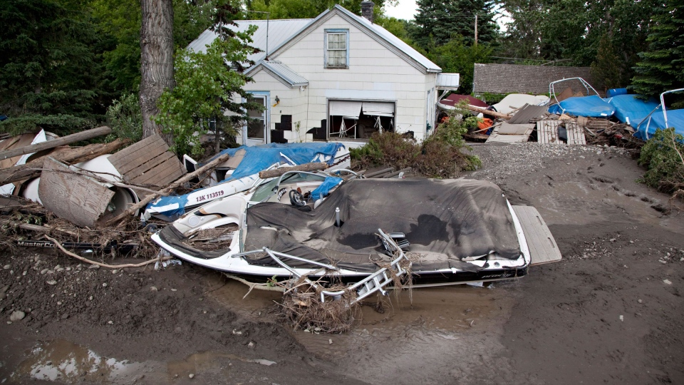 Wreckage lies along Center St. in High River, Alberta on Tuesday, June 25, 2013. (Jordan Verlage / THE CANADIAN PRESS)
