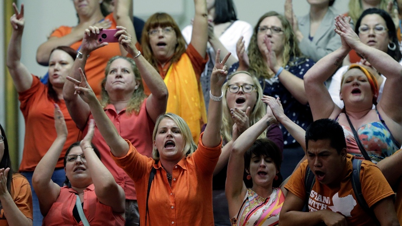 Members of the gallery cheer and chant as the Texas Senate tries to bring an abortion bill to a vote as time expires, Wednesday, June 26, 2013, in Austin, Texas.  (AP / Eric Gay)