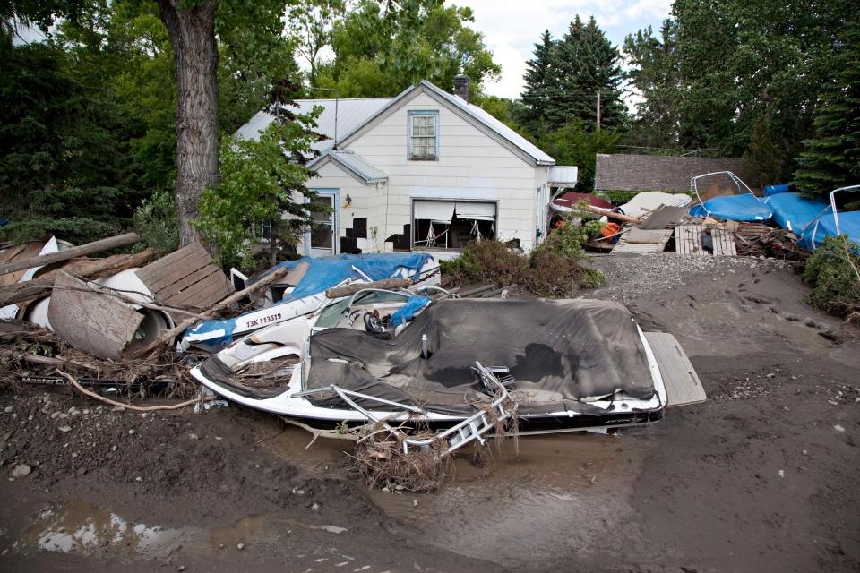 Wreckage lies along Center St. in High River, Alberta on Tuesday, June 25, 2013.  (Jordan Verlage / THE CANADIAN PRESS)