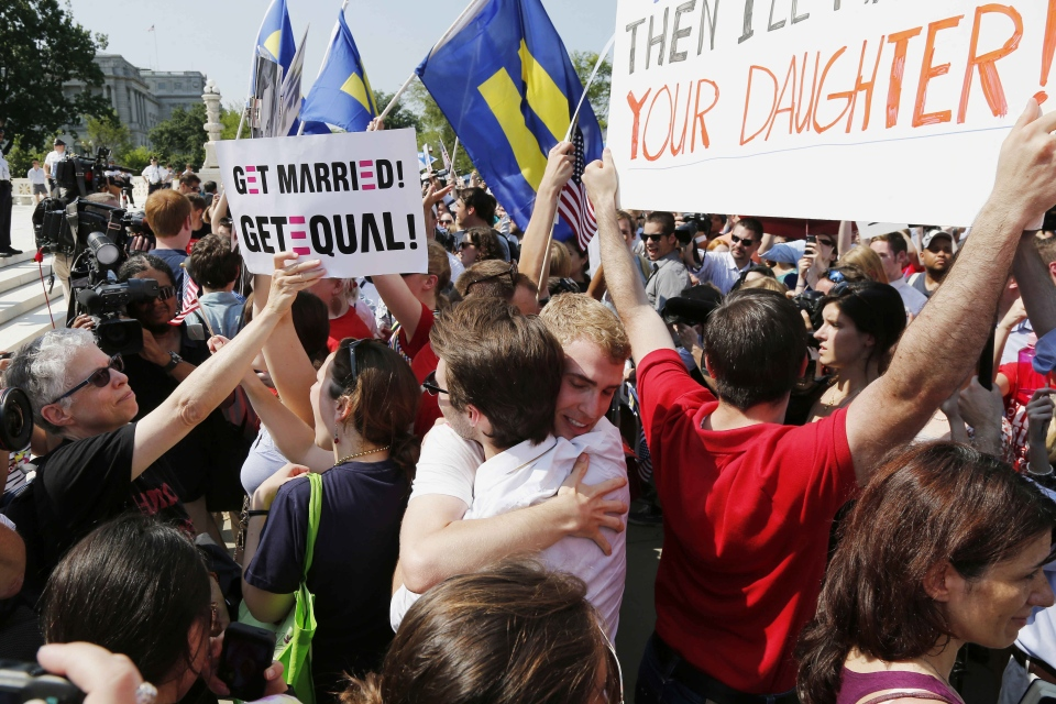 Supporters of gay marriage embrace outside the Supreme Court in Washington, Wednesday, June 26, 2013. (AP / Charles Dharapak)