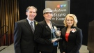 Lisa Rendall is seen with CTV Saskatoon co-anchors Rob MacDonald and Chantel Huber after receiving the CTV Saskatoon Citizen of the Year award on March 11.