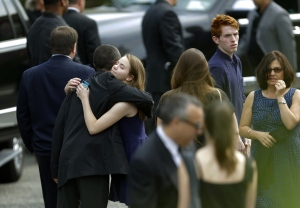 Mourners arrive at Robert Spearing Funeral Home for a private viewing for actor James Gandolfini, Wednesday, June 26, 2013, in Park Ridge, N.J. (AP Photo/Julio Cortez)