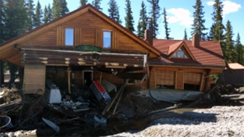 A house is almost in the river in in Bragg Creek, Alta., on Wednesday, June 26, 2013. (Darin Saarela/CTV News)