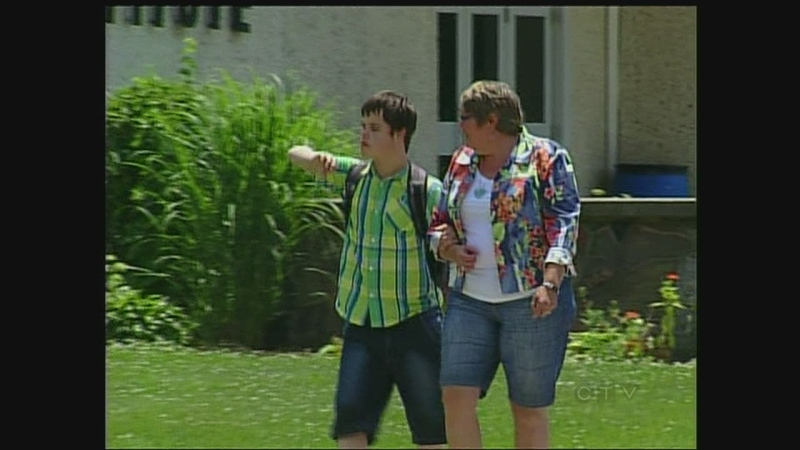 Diane White picks up her son Aidan from school in St. Thomas on Wednesday, June 26, 2013.