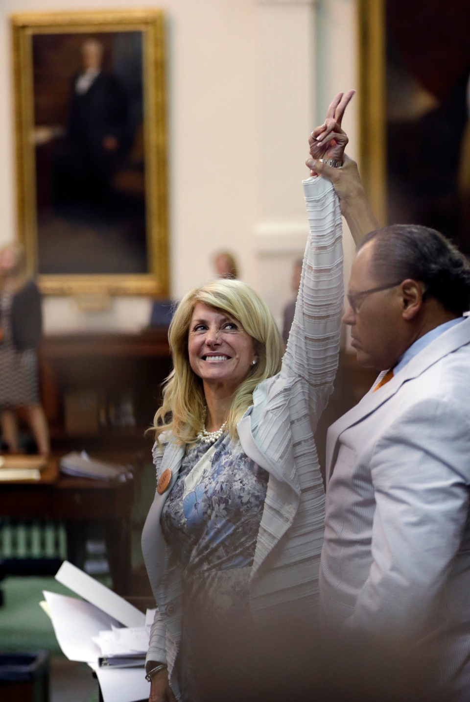 Sen. Wendy Davis, D-Fort Worth, left, who tries to filibuster an abortion bill, reacts as time expires, Wednesday, June 26, 2013, in Austin, Texas. (AP / Eric Gay)
