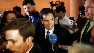 U.S. Sen. Marco Rubio, centre, is followed by reporters as he leaves after speaking at the Faith and Freedom Coalition Road to Majority Conference in Washington, Thursday, June 13, 2013. (AP / Charles Dharapak)
