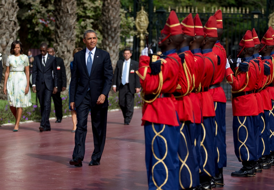 U.S. President Barack Obama is welcomed by a Senegalese honor guard as he arrives at the presidential palace in Dakar, Senegal on June 27, 2013. (AP / Carolyn Kaster)