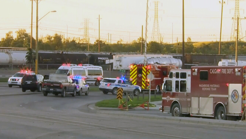 Emergency officials block off a rail bridge on the verge of possible collapse in Calgary, Thursday, June 27, 2013.