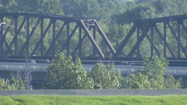 Several cars filled with fuel are on the verge of falling into the Bow River after a section of the Bonnybrook Bridge failed due to fatigue.