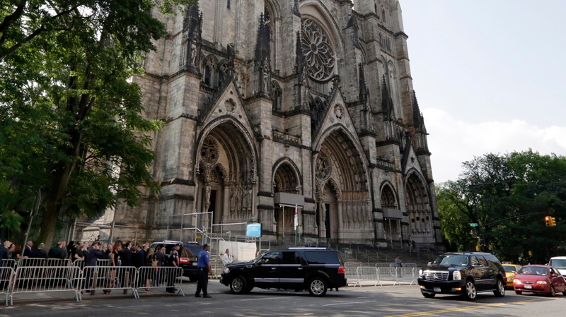 Cars arrive as mourners line-up for the funeral service of James Gandolfini, star of 'The Sopranos,' in New York's the Cathedral Church of Saint John the Divine, Thursday, June 27, 2013. The 51-year-old actor died of a heart attack last week while vacationing in Italy with his son.(AP / Richard Drew)