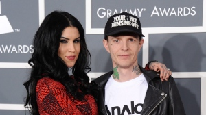 Kat Von D, left, and Joel Thomas Zimmerman, also known as Deadmau5, arrive at the 55th annual Grammy Awards on Sunday, Feb. 10, 2013, in Los Angeles. (Photo by Jordan Strauss  /Invision/AP)