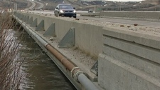 Floodwaters touch the bottom of the Highway 11 bridge in Lumsden on Thursday. The town has declared a local state of emergency.