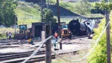 CP rail cars sit crumpled in Calgary